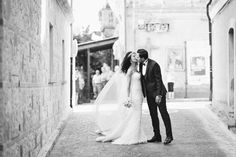 A True Italian Wedding in Calabria. Dress and veil by Oscar de la Renta. Photo by Magnus Bogucki.