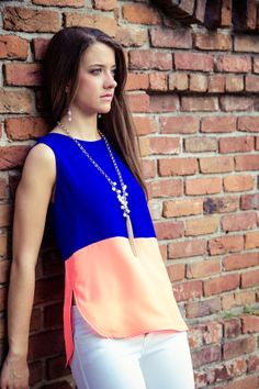 The neon colored tanks are back in! This Royal and Coral tank is an absolute favorite!