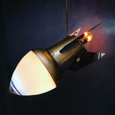 """Omega Lighting & Design makes """"Frankensteined"""" rockets from found items. Each is unique. This 1 is big. 50"""" wide."""