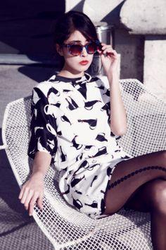 Sunglasses and a cat dress