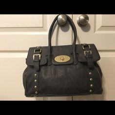 Olivia + Joy handbag!! Beautiful handbag!! Lightly scratched on buckle area but hardly noticeable. Lots of room on the inside, nice pocket space! Very clean and in great condition!! Olivia + Joy Bags