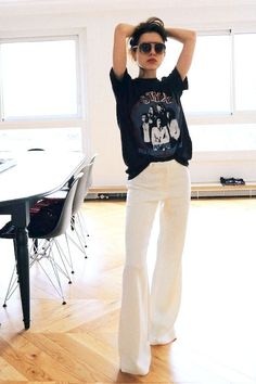 White wide pants and rock tshirts.