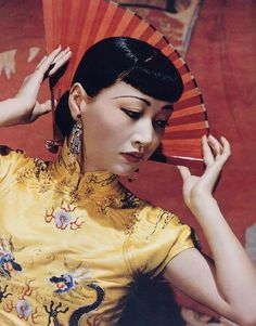 Anna May Wong, 1940s - how wonderful, wearing golden yellow cheongsam