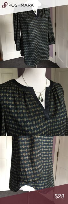 """Ann Taylor Boho Style Top Cute navy print top in a drapey boho style.  3/4 sleeves with elastic at cuff, split neckline with satiny trim, curved hem, 100% polyester.  Center back length: 24 1/2"""", sleeves 19"""", shoulders 14"""", chest laying flat 18"""".  Very good condition.  Thanks for looking! Ann Taylor Tops Blouses"""