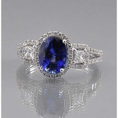 Oval Sapphire and Diamond Halo Ring ($12,900) ❤ liked on Polyvore featuring jewelry, rings, princess cut halo diamond ring, holiday jewelry, oval sapphire ring, sapphire cocktail ring and blue druzy ring