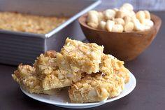Keto and sugar free coconut macadamia bars with a shortbread crust