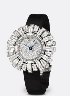 "BREGUET-""Petite Fleur"" Wristwatch in 18-carat white gold. Caseband set with 43 petals of diamond baguette on a mobile setting, totalling approx. 12.60 cts. Dial flange set with 48 diamonds, approx. 0.10 ct. Balance spring in silicon. Dial paved with 141 diamonds, approx. 0.52 ct. Self-winding movement. Sapphire caseback. Diameter: 17mm. Also in yellow gold."