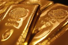 Gold prices held near the prior session's nine-week high on Monday, as market players sought refuge amid heightened volatility in global stock markets.