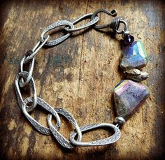 Love the hammered rustic chain with labradorite nuggets by Lorelei  Eurto Jewelry.