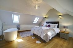 The fabulous master bedroom at the Pump House in Ilkley comes complete with free-standing bath.
