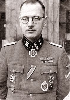 Waffen SS-Obersturmbannführer (Lt Col) Nikolajs Galdiņš was a Latvian winner of the Knight's Cross of the Iron Cross. He distinguished himself during fighting in the Kurland Pocket, Leningrad Front and was decorated with the German Cross in Gold in addition to the Knight's Cross. At the end of the war, he was arrested by the Russians and was executed on Oct 5, 1945. Note his collar badge with the swastika instead of the SS runes.
