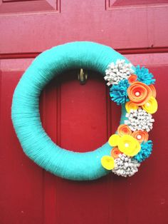 """12"""" Teal Yarn Wreath with Yellow, Orange and Gray Felt Flowers on Etsy, $26.00"""