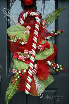 Love this instead of a traditional wreath! christmas wreaths, candi, christmas candy, front doors, candy canes, candy cane wreath, mesh wreaths, christmas swags, christmas door
