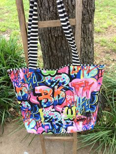A personal favorite from my Etsy shop https://www.etsy.com/listing/511224904/urban-funk-graffiti-reversible-tote
