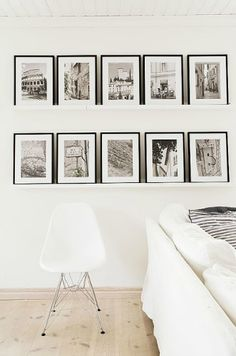 By arranging pictures on shelves, you can really express yourself with several different elements. Like sleek and modern? Pick some nice black boxy-looking shelves. Shabby chic? Go to your local antique shop and pick out some nice vintage shelves with cornices. Then coordinate the frames and mats to work with the look of shelves. Shelves can help keep a modern and contained look to the display.