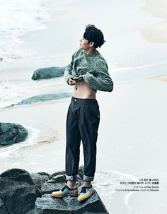 GUY CANDY: Heir's Kang Ha Neul takes to the waves