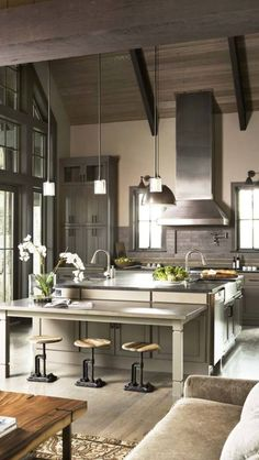 Industrial meets natural.  I like this kitchen for the cool neutral colors and the wood paneling on the ceiling.