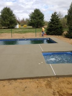 The pool and spa concrete decking is complete.