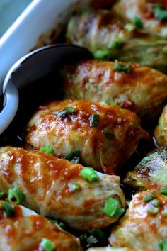 Spicy Asian Pork Cabbage Rolls - Close-up of cooked cabbage rolls in white baking dish with white metal spoon Pork And Cabbage, Cabbage Recipes, Pork Recipes, Asian Recipes, Chicken Recipes, Cooking Recipes, Healthy Recipes, Cooked Cabbage, Cooking Tips