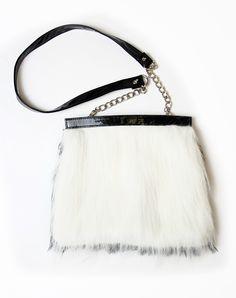 Motel Reversible Fur Shoulder Bag in Black and White http://www.motelrocks.com/shop/products/Motel-Reversible-Fur-Shoulder-Bag-in-Black-and-White.html #vintage #retro #90s #fur #fauxfur #white #fluffy #bag #moleskin #accessories