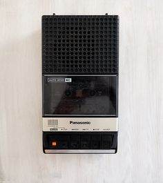 Panasonic RQ-2107. Made in Japan, 1978. Player and recorder works excellent. Few scratches on the surface. Has an extendable handle on top. Runs with