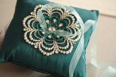 NU is the epitome of glamor, exquisite beadwork on luxurious silk fabric. The pillow measures approximately 6 inches on each side. Finished with blue organza ribbon in the center for the rings. Shippi