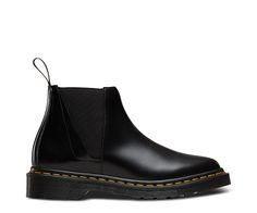 Echoing early 80's Gothic style of dainty, pointed ankle boots, the low height Bianca Chelsea Boot is new for this season. The Polished Smooth leather gives the boot a classic, premium feel, whilst the front panel cleanly wraps around the toe from the throat, and side elasticated paneling offers ease of entry. Maintaining the classic Dr Martens trademarks, Bianca includes yellow Z-welt stitching, iconic tread pattern and heel loop. The bouncy AirWair sole is oil-and-fat-resistant, hard…