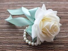 Wrist Corsage, Off White Rose with Mint ribbon on pearl bracelet