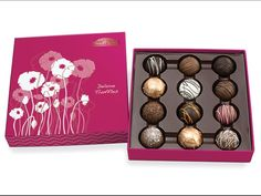 Rocky Mountain Chocolate Factory as a variety of French-inspired treats, including the Deluxe Truffle Assortment, featuring twelve flavours of gourmet truffles in a spring-themed gift box.