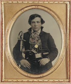 +~+~ Antique Photograph ~+~+  Unidentified soldier in Confederate uniform with cavalry sword and revolver.  Sixth-plate ambrotype hand-colored.