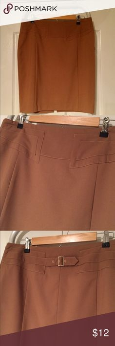 "Express skirt (NWOT) Versatile camel colored skirt. Light weight polyester blend. Fully lined with front and back accent design. Hem is 21"" from waist. Skirts"