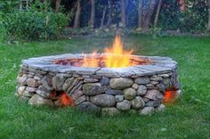 Diy Firepit with openings at the bottom for airflow and to keep feet warm…flat top~i love the cobblestone look!
