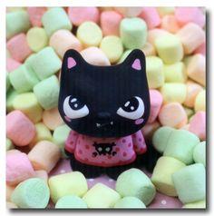 des guimauves avec un chat bonbon dessue♥