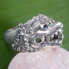This exotic traditional design has a magical combination of sterling silver with blue Sapphires to make it a gorgeous and eye catching ring to wear.