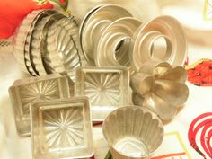 Rustic aluminum mini pans, set of 15, include 4 bundt, 4 ring, 3 jello molds, 3 square baking tins and 1 heart mold.  2.5 x 3 (square baking