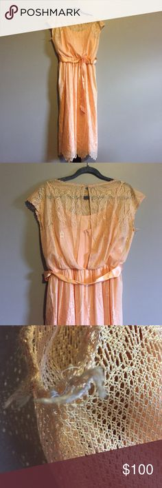 "Vintage LLGWU Lace Dress Prom Bridesmaid Wedding Vintage 50's 60's Peach Lace Dress made by Ladies Garment Workers Union LLGWU. This dress has a ribbon belt with flower attached. There is a matching lining under the Lace with spaghetti straps. A few spots that would need repair, see photo for Example, but nothing very noticeable. Otherwise in excellent condition! The waist measures 27"" and length from waist down is 36"". Would be perfect for a party, prom, bridesmaid or alternative wedding…"