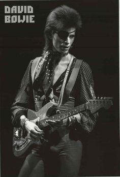 David Bowie does some Glam Rock swash-buckling in this great poster of him with eyepatch and Hagstrom guitar! Ships fast. 24x36 inches. Check out the rest of our amazing selection of David Bowie poste