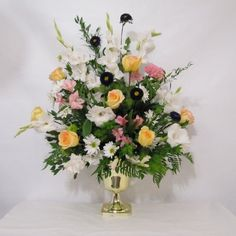 Altar Flowers Tutorial; See free step by step tutorials for church decor, bouquets, corsages, boutonnieres and much more!