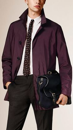 Burberry Burgundy Leather Detail Technical Car Coat - A showerproof car coat in a protective technical fabric. A concealed button closure complements the tailored lines.