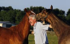 Martin O'Dowd, general manager and vice president of Runnymede Farm, held two yearling fillies at sunrise at the 145-year-old Paris farm. CHARLES BERTRAM — Herald-Leader