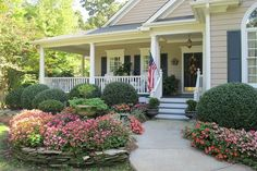 beautiful front porch and flowers