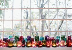 Mixed Jewel Tone Jars and Votives || Bring some color to the table on the wedding day. Table Decor Wedding, Reception Decorations, Wedding Jars, Boho Wedding, Garden Wedding, Wedding Bells, Whimsical Wedding, Dream Wedding, Wedding 2015