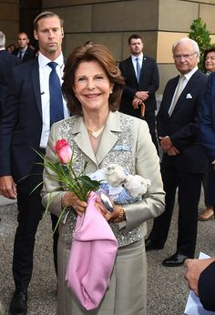 Queen Silvia of Sweden with husband King Carl Gustaf of Sweden (R) arrives at the Residenz in Munich, on July 24, 2017