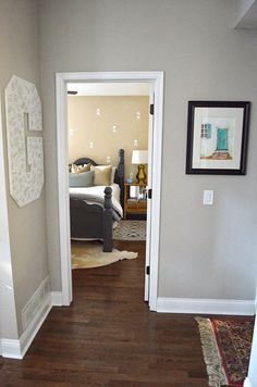 The Happy Homebodies: Guest Bedroom Makeover for $7.48. Neutral, cozy guest room with beige walls. Hallway painted Revere Pewter by Benjamin moore