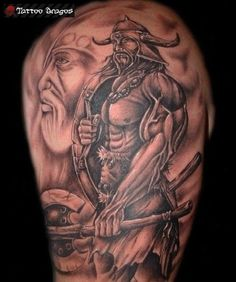 Viking armored with weapons tattoo