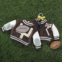Mud Pie Football Jacket.  These jackets are simply adorable for your favorite little football fan.  Now your little guy can look just like one of the big boys.