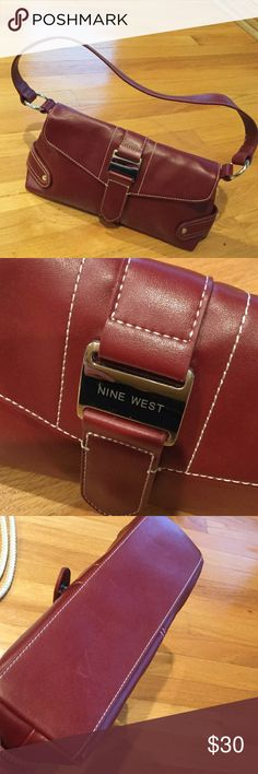 Small hand bag Small dark red handbag with silver hardware. Worn once, then stored away. Still looks new. Nine West Bags Shoulder Bags