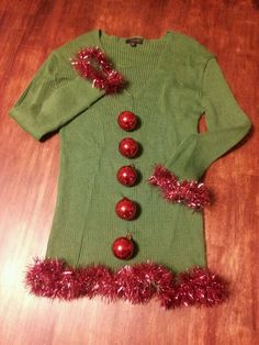 The perfect homemade ugly Christmas sweater!!!!    Directions: 1. Pick out favorite sweater (preferably green or red).  2. Sew tinsel onto bottom of sweater and sleeve cuffs.  3. Sew small and light weight Christmas ornaments down the front like buttons.