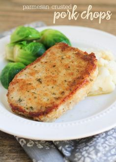 Parmesan Crusted Pork Chops - one of our favorite recipes. AND it's EASY! Recipe on { lilluna.com } Breadcrumbs, parmesan cheese, paprika, parsley, garlic, and olive oil combined to give these pork chops a crispy, flavorful taste!
