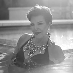 Kris Jenner in black swimsuit and statement necklace for LOVE